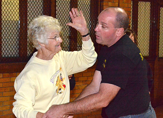 Van Wert County Sheriff's Deputy Ed Klausing teaches a woman about self-defense during a previous class. (VW independent file photo)