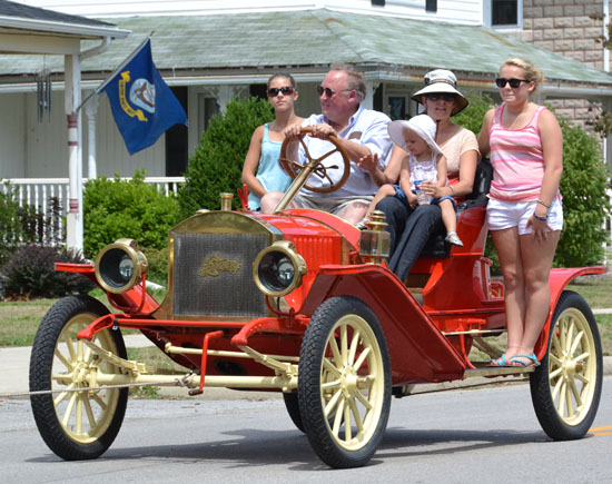 Members of the Lambert family drive an antique Lambert automobile in the 2012 Lambert Days Parade. (VW independent file photo)