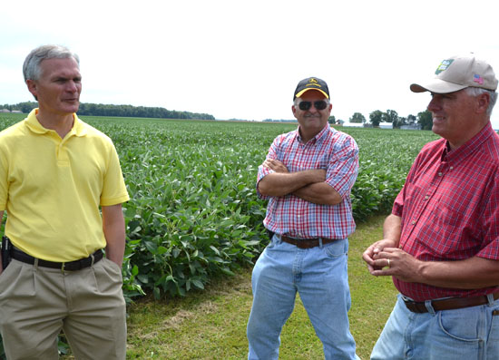 U.S. Representative Bob Latta (left) talks with Kevin and Mike Heffelfinger at their Greenville Road farm. (Dave Mosier/Van Wert independent)
