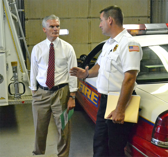 U.S. Representative Bob Latta (left) talks with Middle Point Fire Chief Craig King about that village's firehouse project on Thursday. (Dave Mosier/Van Wert independent)