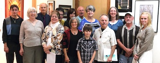 Winners who attended the 36th Annual Wassenberg Photography Exhibit gathered for a group photo following the awards presentation. (Photo submitted.)
