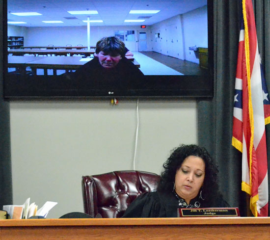 Tamara Menke (shown in television) made an initial appearance in Van Wert Municipal Court via a video conference Friday afternoon on a charge of murder. Judge Jill Leatherman reads the charge. (Dave Mosier/independent editor)