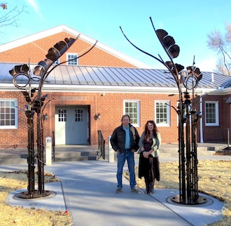"Mike Bendele and Hope Wallace stand beside Bendele's completed sculpture, ""The Portal,"" provided to the Wassenberg Art Center by First Federal of Van Wert. (All photos submitted.)"