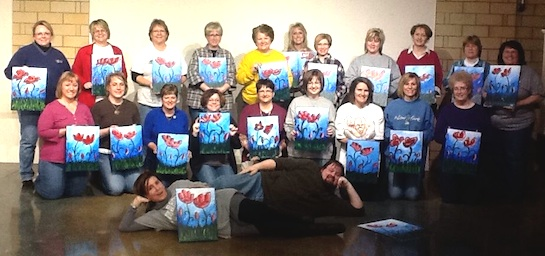 The Central Mutual Insurance Customer Service group attended a Vine & Palette painting event at the Wassenberg Art Center. They are shown here holding their completed paintings.  (Photo submitted.)