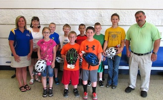 Pictured above are the winners of the Kids Health Fair Quiz. Students received a helmet as a reward. Standing along with the students are Nurse Candice Elliott, Dr. Matthew Miller, and Principal Mckinney. (Photo submitted.)
