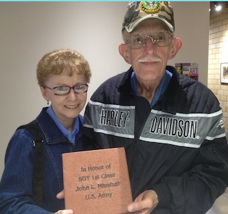 John and Therese Marshall proudly display the brick paver that honors John's service in the U.S. Army as a Sargent First Class. Pavers can be purchased by anyone wishing to honor a loved one. Pavers are to be installed in the front of the building by the garden pond. (Photo submitted.)
