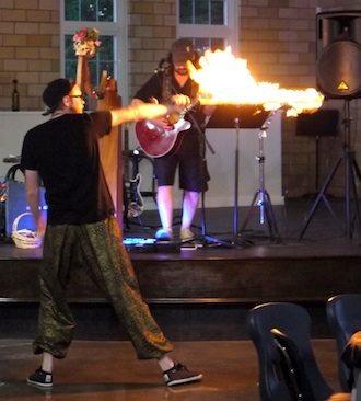 A fire dancer from Pyroscope Entertainment perform with Dan Dickerson & The Harp Condition in the gallery during the opening reception of the 58th Annual June Art Exhibit held at the Wassenberg Art Center. All exhibits are free and open to the public. (Photo submitted.)