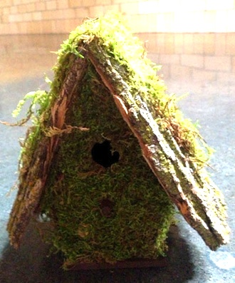Randy Scholl's moss covered birdhouse donated to the Wassenberg fund raising auction will be taking place this weekend at the art center. (Photo submitted.)