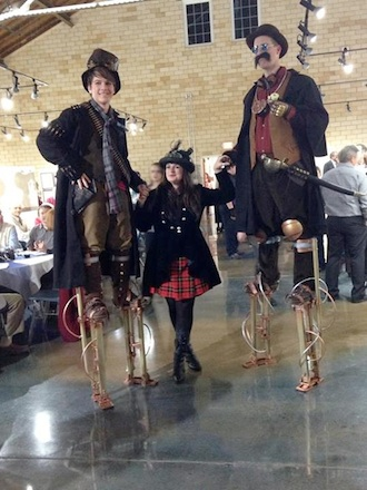 The Ganser Family on steampunk-style stilts, from T.A.G. Art in Fort Wayne and Hope Wallace pose for the camera at one of the Wassenberg Art Center's large events. (Photo submitted.)