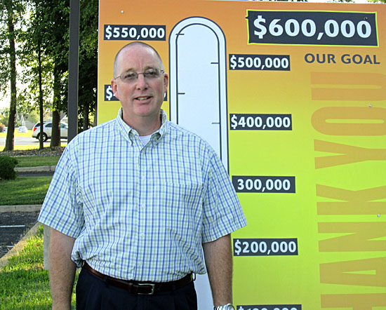 2014 United Way Campaign Chair Scott Mull poses with the thermometer showing this year's $600,000 goal. (photo submitted)