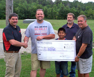 Scott and Cody Lautzenheiser present a check in the amount of $13,010 to Ben Price, Steve Lichtensteiger and John Voltz. (photo submitted)