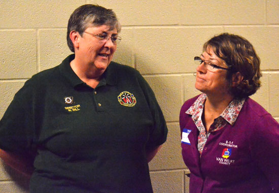 Newtown, Connecticut, Communications Director Maureen Will (left) chats with Van Wert County 9-1-1 Coordinator Kim Brandt following Will's presentation at a seminar held Wednesday at Vantage Career Center. (Dave Mosier/Van Wert independent)