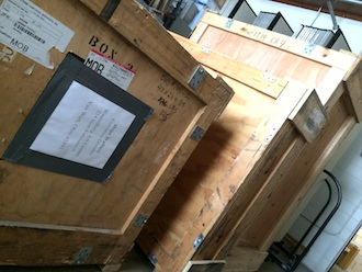 Crates containing 40 watercolors from the American Watercolor Society await display at the Wassenberg Art Center. (Photo submitted.)