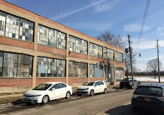Exterior of a formerly abandoned factory in the Franklinton neighborhood of Columbus. Revitalization has springboarded after artists moved into the space. Within just two years, a restaurant, and a brewery have moved into the 400 Rich Street Studio area. (Photo submitted.)