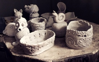 Pottery projects from the Wassenberg Art Center pottery class waiting to be fired. (Photo submitted.)