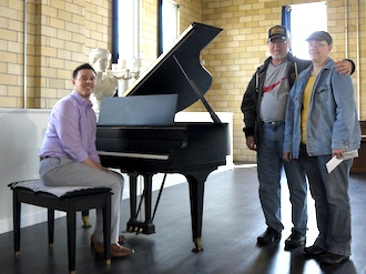A 1928 A.B. Chase baby grand piano was donated to the Wassenberg Art Center from Joseph and Annette Atkins of Vandalia and arrived on April 21. Pictured from left to right, Seth Baker, Joseph and Anette Atkins. (Photo submitted.)