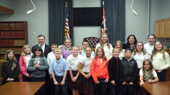In coordination with National Law Day, the 4th, 5th, and 6th grade students of St. Mary of the Assumption Catholic School visited the Van Wert Municipal Court on Thursday, April 30. Students were able to watch Municipal Court Judge Jill Leatherman, Van Wert City Law Director John Hatcher, and Probation Officer John Wiley, carry out the arraignment process. The students heard the pleas and charges from the defendants. After the arraignments, students were able to have a question and answer session with Judge Leatherman, Hatcher, and Wiley regarding the arraignment process specifically and the court system in general.  (Photo submitted.)
