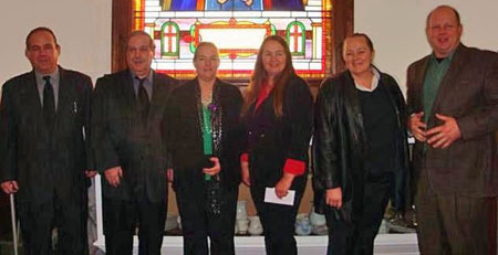 The six surviving Rigdon children, now in their 50s and 60s, pose for a recent photo.