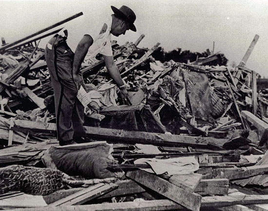 Then-Van Wert County Sheriff Wilmer Clay sifts through debris at the Rigdon residence. (photos submitted)