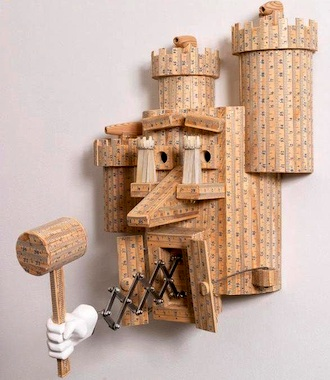 A sculpture made of recycled wooden yardsticks is just one example of the materials artist Robert Millard-Mendez uses to create his unique work that is often tinged with humor. Mendez will be on exhibit at the Wassenberg Art Center beginning on Aug. 15. (Photo submitted.)