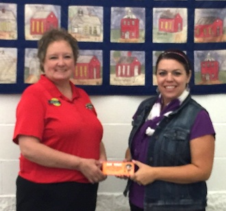 Schlotzsky's Bakery Café donated 50 kids' meals to Lincolnview Elementary School's LANCER Life Skills program.  The program is designed to reward students who put forth extra effort at school.  Shown are Tammy Rice, Catering Manager at Schlotzky's, and Tonia Verville, Elementary Counselor. (Photo submitted.)