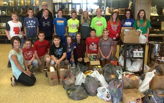 Friday, Sept. 25, was the United Way Day of Caring.  All together students in grades seven through 12 collected over 1600 nonperishable food items that will be distributed in the Van Wert area. Beth Schnipke's and Julie Miller's Lancer Time classes, shown in the photo, collected the most items. (Photo submitted.)