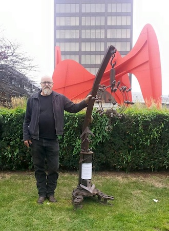 Richard Alan Morgan poses with his sculpture at ArtPrize, the largest art competition in the world. The sculpture was originally shown at the Wassenberg Art Center Artist Member's Exhibit in 2014. (Photo submitted.)