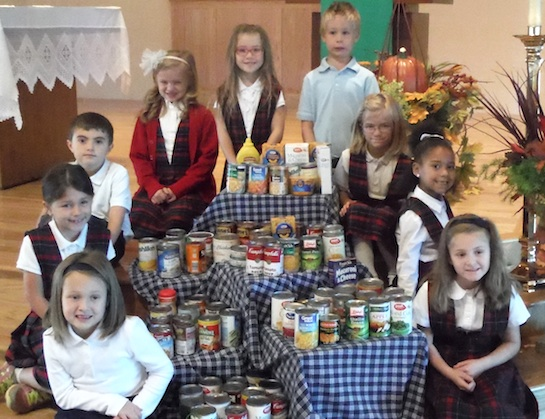With the Holiday season coming, St. Mary of the Assumption Catholic School collected canned goods to donate to the Cooperative Ministries Food Pantry at First United Methodist Church.  (Photo submitted.)