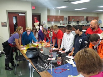 These Van Wert 8th graders try to figure out the names of medical equipment and devices during their visit to the Health Technology lab. (Photo submitted.)