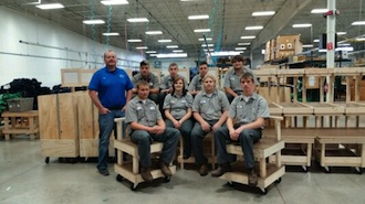 Universal Lettering General Manager Cory Hoops and a few of the members of the Vantage Junior Carpentry class show off the latest sewing cart project.  Students pictured are (front row) Nathan Soto (Continental), Brittany Bergman (Wayne Trace), Sam Vetter (Ft. Jennings), and Josh Fowler (Van Wert).  (Back row) Tyler Bauer (Paulding), Nick Burgoon (LifeLinks), Andrew Krogman (Parkway) and Kori Wolfrum (Paulding).  (Photo submitted.)
