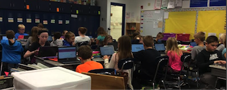 Students in Matt Allesandrini's fourth grade math class use Chromebooks to collect data quickly for prompt, organized presentation to the teacher.  Alessandrini can then use the data in his next lesson to help those who didn't understand the topic and challenge those who did. (Photo submitted.)