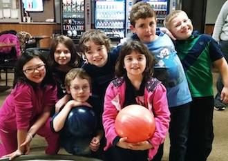 The Lincolnview Learning Academy had a blast at Olympic Lanes after school on Thursday Dec. 17. From left are: Josie, Harlee, Zachary, Steven, Jamie, Isaiah, and Keagan.  (Photo submitted.)