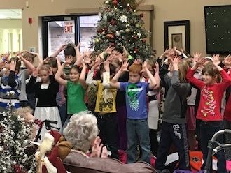 """""""The best way to spread Christmas cheer is singing loud for all to hear."""" Third graders spread Christmas cheer to audiences at Wee Care Learning Center, Van Wert Manor and Vancrest in Van Wert by singing songs, passing out candy canes and handing out Christmas cards. Lincolnview thanks these organizations for hosting the children.  (Photo submitted.)"""