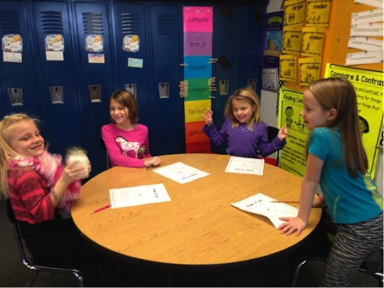 Mrs. Debell's second grade students were asked to investigate what would happen to cream when it is shaken. Students were asked to form a hypothesis, draw conclusions and communicate their results.  (Photo submitted.)