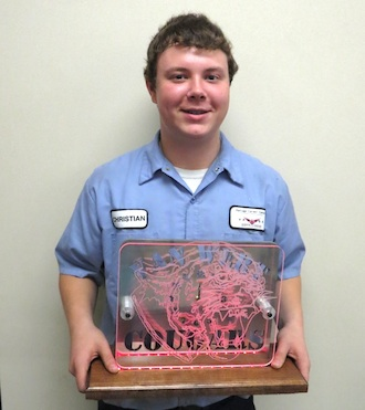 Christian Riley, a Van Wert senior in the Vantage Precision Machining program is pictured with the customized school mascot clock he made.  The clock will be raffled off at the Van Wert/Marion Local basketball game on Saturday, Jan. 9, 2016.  Presale tickets for the clock are available in the Van Wert high school office. (Photo submitted.)