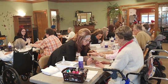 Cosmetology students from Vantage visited Country Inn Assisted Living Center and Nursing Home in Paulding to spread some holiday cheer.  Those who wanted received a hand massage or manicure. (Photo submitted.)
