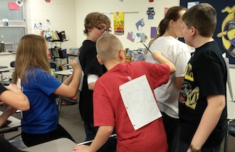 """Brenda Leeth, Lincolnview Jr/Sr High guidance counselor, recently spent a class period with seventh grade students.  The students did an exercise to see what it feels like to say something good """"behind people's backs"""".  At the end of the period, the students were challenged to find their """"theme song(s)"""".   The students will include these in their time capsule, which will be opened when they are seniors.  (Photo submitted.)"""