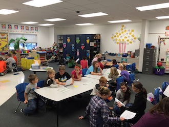 Lincolnview sixth graders share their fairy tale creations with Kindergarten students. (Photo submitted.)