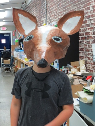 Papier maché masks were made by ArtReach students at the Wassenberg Art Center. ArtReach is an afterschool art program offered by the art center and open to area students ages 7–15. (Photo submitted.)