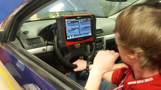 Maxwell Bennett, a Van Wert sophomore, is in the driver's seat as he checks out a diagnostic tablet attached to the steering wheel in the Auto Tech lab during Sophomore Day at Vantage. (Photo submitted.)