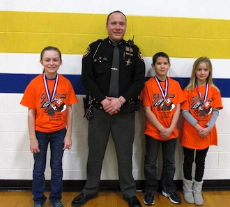 Lincolnview Elementary students participated in the essay contest held by the DARE program. The winners were Zada Walker, Gabe Bill and Taylor Garver. Also pictured is Van Wert County DARE officer, Deputy Mike Biberstine. (Photo submitted.)