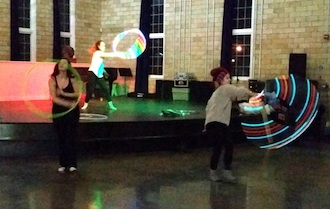 ArtNight is a free gathering held every Thursday night at the Wassenberg Art Center. Artists are encouraged to bring work or start a project at the center. Last week the gallery was lit up hoop artists, music and art. (Photo submitted.)