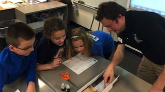 Carter Renner, Maceyn Snyder, and Breck Evans are pictured with Dale Ruppert of Science Central out of Fort Wayne, Indiana.  Dale met with all the fifth graders at Lincolnview Elementary to teach a hands-on lesson with Newton's three laws of motion. (Photo submitted.)