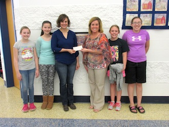 Firehouse Pizza of Middle Point presents a check from their fundraiser for the Lincolnview Elementary School.  Shown are Elementary Principal Nita McKinney, Molly Welch, and sixth grade students.  The school thanks Firehouse Pizza and its patrons for their support.  (Photo submitted.)