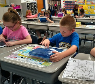 First graders in Amy Overholt's class are shown studying math facts on Learn Pads. (Photo submitted.)