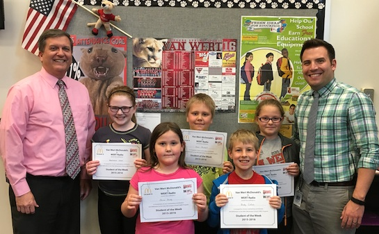Congratulations to the Van Wert Elementary School Students chosen for the Word of the Week award!  Pictured with Mr. Gehres, Principal, and Mr. Krogman, Assistant Principal, are students recognized for being good listeners.  Award winners this week are Olivia, grade 1; Brody, grade 2; Aaron, grade 3; Alexis, grade 4; and Mackenzie, grade 5.  Each child received a free Mighty Kids Meal from our local McDonalds, a Bounce Certificate from The Kangaroo Cave, Delphos, and a certificate from WERT Radio. (Photo submitted.)