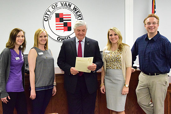 "Van Wert Mayor Jerry Mazur reads a proclamation recognizing the YWCA of Van Wert County's ""Stand Against Racism."" Events begin Thursday and run through Sunday. Shown with the mayor are YWCA staff members Jamie Evans, Jody Wannemacher, Kimberly Laudick, and Gabe McConn. (Dave Mosier/Van Wert independent)"