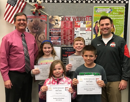 Congratulations to the Van Wert Elementary School Students chosen for the Word of the Week award.  Pictured with Mr. Gehres, Principal, and Mr. Krogman, Assistant Principal, are students recognized for being honest.  Award winners this week are Katy, grade 1; Raven, grade 2; Joey, grade 3; Joaquin, grade 4 (absent from photo); and Ian, grade 5. Each child received a free Mighty Kids Meal from our local McDonalds, a Bounce Certificate from The Kangaroo Cave of Delphos, and a certificate from WERT Radio. (Photo submitted.)