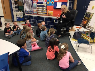 Kindergarteners listening intently to a local author, Deborah Ambroza. (Photo submitted.)