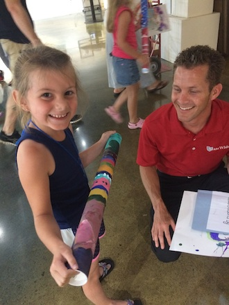 A young artist enjoys her rainmaker created during Summer Youth Art in 2015. (Photo submitted.)